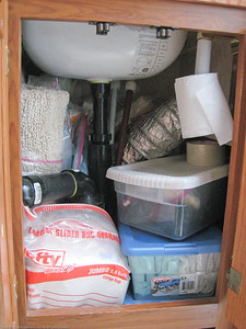 Head under-sink cupboard pack. There is additional storage to the right that we used for long-term storage as it was tough to reach in there. Hot water heater  is to the left. Rincon del Viajero. Otavalo, Ecuador.