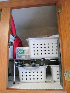 Upper right galley cupboard pack. Note the knives in knife guards. We brought our good pans and knives and never regrettted it. Having those quality items along made a huge difference in day-to-day life. Rincon del Viajero. Otavalo, Ecuador.