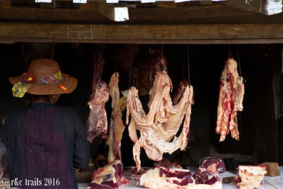 a local woman buying her meat from the butcher