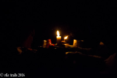 at night time, hawkers sell their goods by candlelight