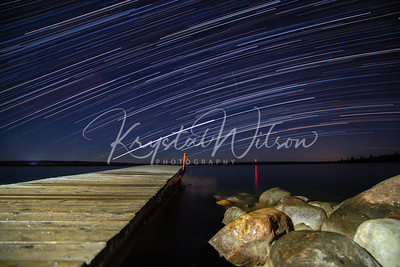 Star Trails Over The Boat Launch