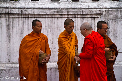 monks giving alms to monks