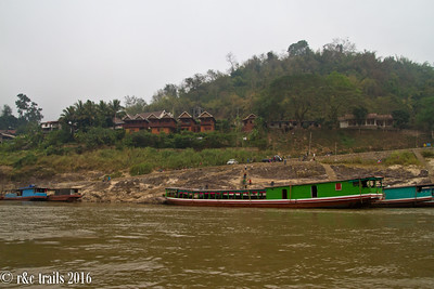 long boats used for mekong river transport