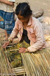 a local making pieces for thatched roofs