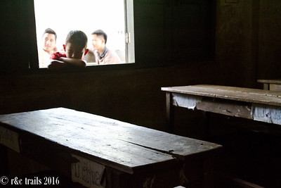 peering inside the school house, probably wondering what we're doing here