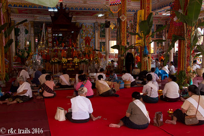 women gathering at wat that luang - the most important temple in laos