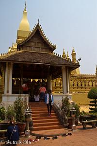 worshippers at wat that luang stupa