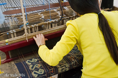weaving a traditional lao women's skirt