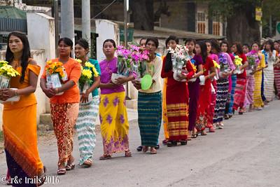 women then follow the girls, akso carrying offerings