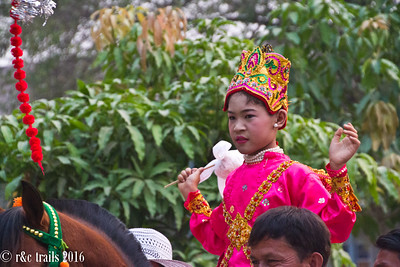 the young boy about to go to monk school.  this dress is to imitate that of a young prince.