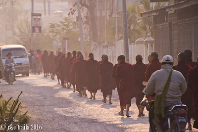 monks doing their alms rounds