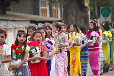 young girls follow, carrying offerings