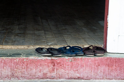 monk shoes waiting outside the monestary temple