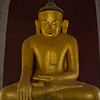newly painted buddha inside one of the smaller temples