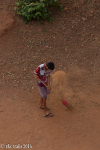 not familiar with the phenomenon of sweeping dirt, but this boy was doing a good job of it.