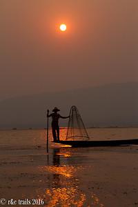 the tourist-posing fisherman