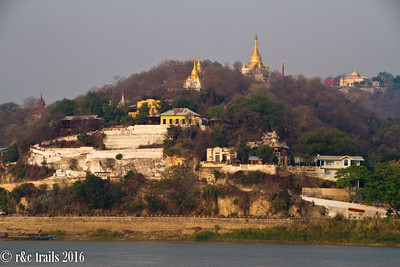 golden stupas line the hillsides