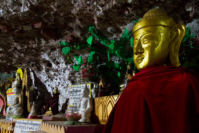 the strange caves of Shwe U Min Paya filled with golden Buddhas