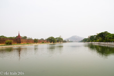 the moat surrounding mandalay palace, mandalay hill in distance