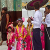 young boys dressed as princess are paraded around temples before going to monk school