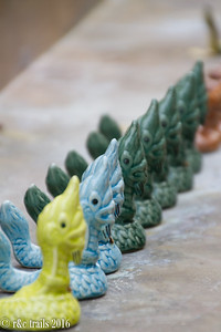 naga (water serpent) figurines line the shelf of a stupa at wat pra sing