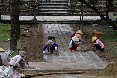 ladies doing the hard work at tu duc's tomb