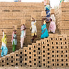 Stacking mud bricks in the form of a kiln for firing
