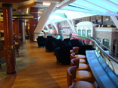 Schooner Bar has great views of the Promenade Deck for people watching.