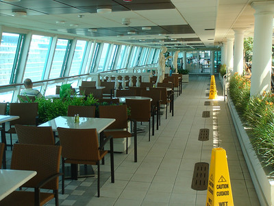 Tables are located on both sides of the ship for the Park Cafe