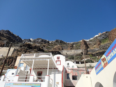 Looking up at Fira from the old port.