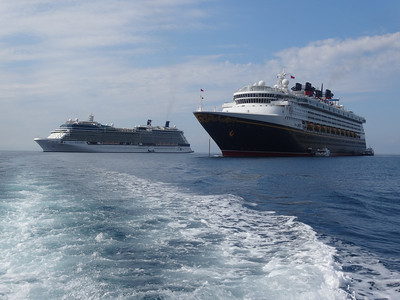 Celebrity Equinox and Disney Magic anchored in Villefranche, France