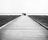Taken on the Lytham Front, just using geometry to bring perspective to the family walking along the pier and the cityscape in the background