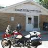 Sidney, TX 76474.  Cute little girl couldn't figure out was the fireman on the motorcycle was doing!