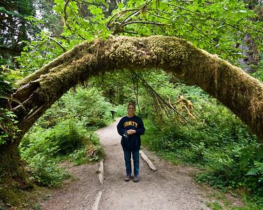 Chris under arch in Hoh Rainforest.