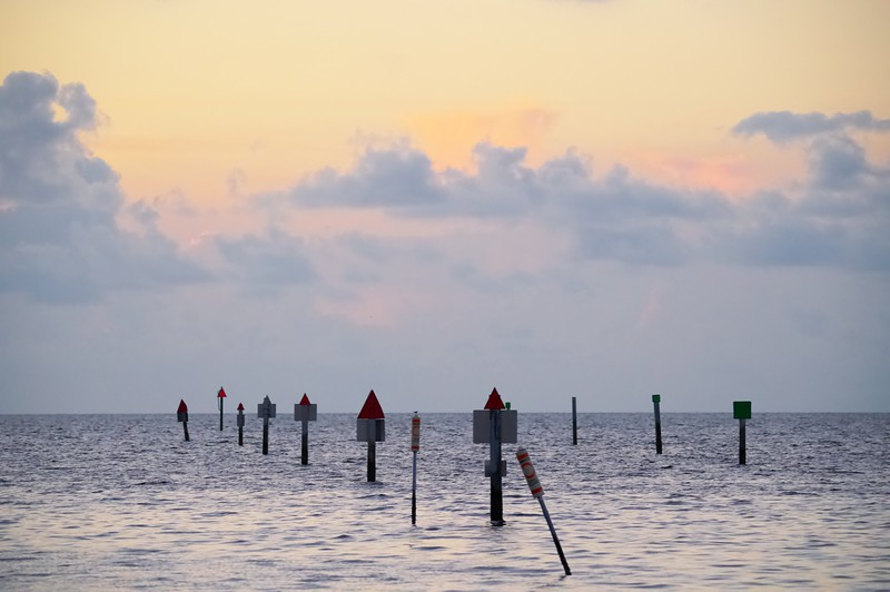 Channel Markers At Sunrise