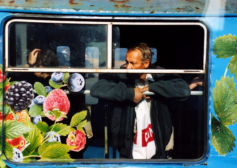 A man riding a Moscow city bus.