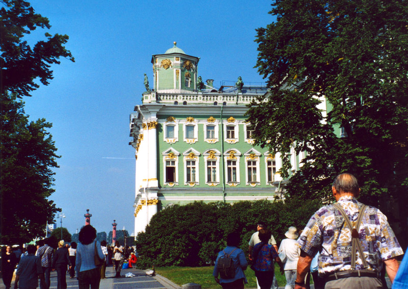 A partial view of a huge Hermitage Museum Building in St. Petersburg. All buildings are in green and white.