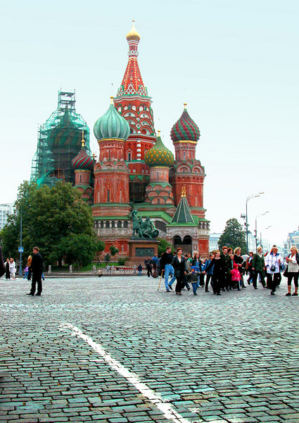 """The famous St. Basil's Cathedral was commissioned by Ivan the Terrible and built on the edge of Red Square between 1555 and 1561. Legend has it that on completion of the church the Tsar ordered the architect, Postnik Yakovlev, to be blinded to prevent him from ever creating anything to rival its beauty again. (He did in fact go on to build another cathedral in Vladimir despite his ocular impediment!) The cathedral was built to commemorate Ivan the Terrible's successful military campaign against the Tartar Mongols in 1552 in the besieged city of Kazan. Victory came on the feast day of the Intercession of the Virgin, so the Tsar chose to name his new church the Cathedral of the Intercession of the Virgin on the Moat, after the moat that ran beside the Kremlin. The church was given the nickname """"St. Basil's"""" after the """"holy fool"""" Basil the Blessed (1468-1552), who was hugely popular at that time with the Muscovites masses and even with Ivan the Terrible himself. <br /> <br /> Information taken from Moscow-taxi.com"""
