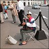 A young panhandler in the streets of Moscow. Beyound you can see another panhandler, a mother and child.