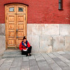 A woman worker resting outside the steps of a building in Moscow, inside the Kremlin walls.