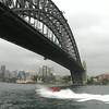 Sydney Harbor Bridge with jet boat.