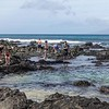 To the left, coming to the beach, the sharp lava rock make  tidal pools