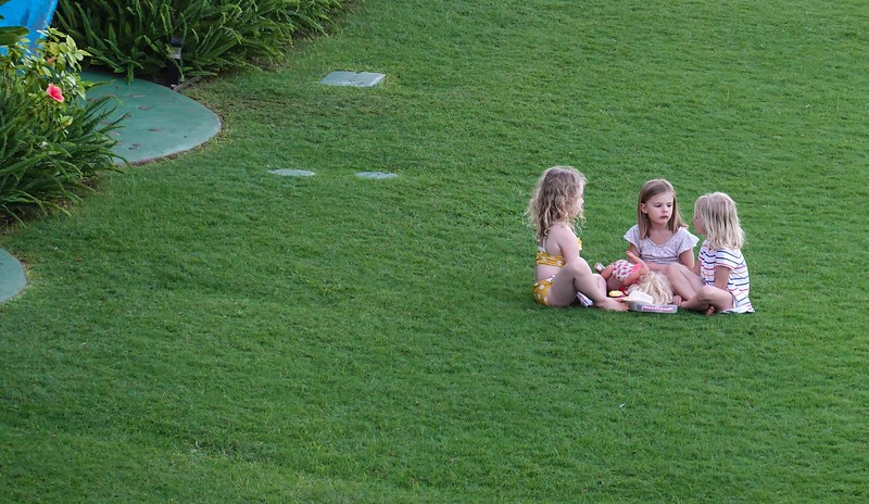 Guests enjoy the beautifully maintained lawns