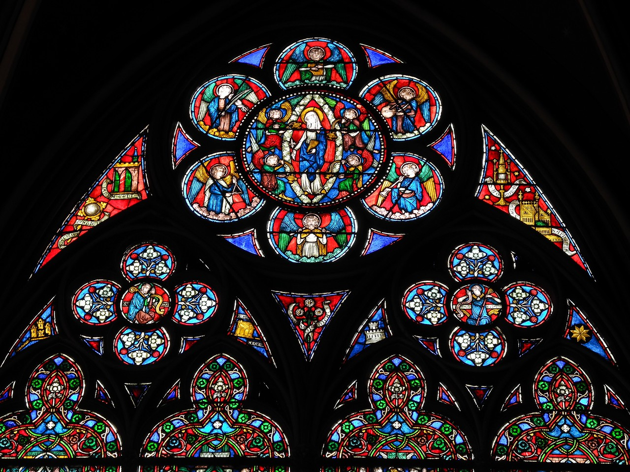 ND23: The stained glass inside the cathedral takes my breath away with its beauty. All the small areas telling holy stories.