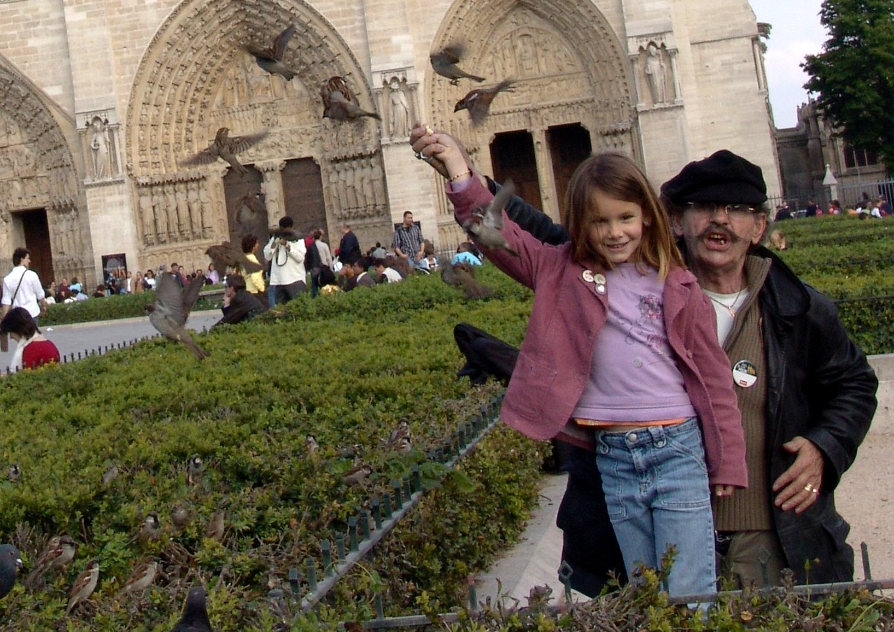 NDex5: This man feeding the sparrows and posing with this cute little girl, has a little business where he sells bags of bird food to tourists for half a Euro (55 cents). Do you remember what the French money was called before it became the Euro?