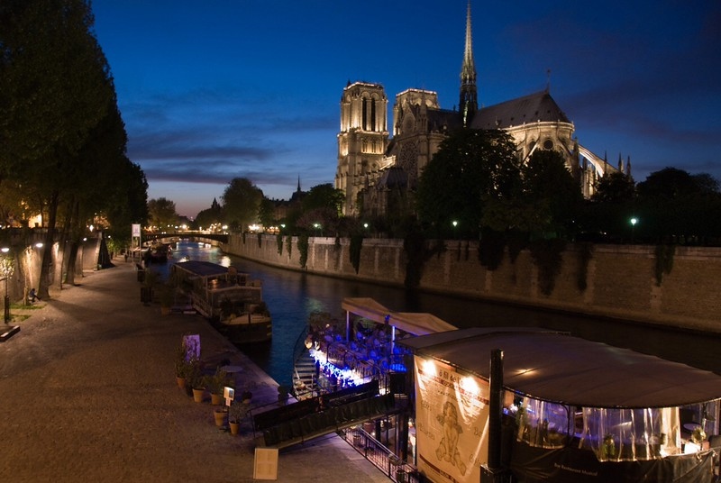 ND24: View at dusk of the back of Notre Dame looking along the SeineRiver. When the sun goes down the magic starts to happen around Paris!!  The lights come on, the sky glows and reflections dance on the river.