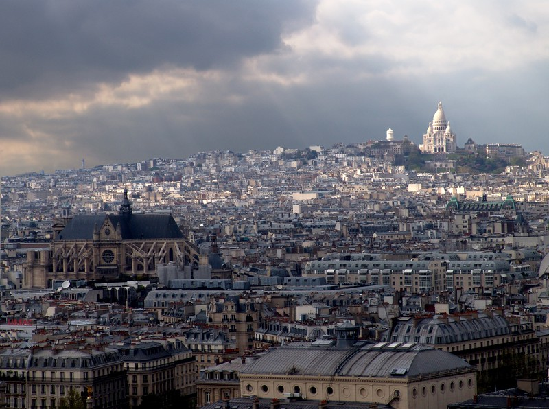 ND21: As I was standing at the top, gazing out across the city, the sun came out from a passing rain shower and a beautiful beam of light illuminated Montmartre, another famous cathedral in Paris.