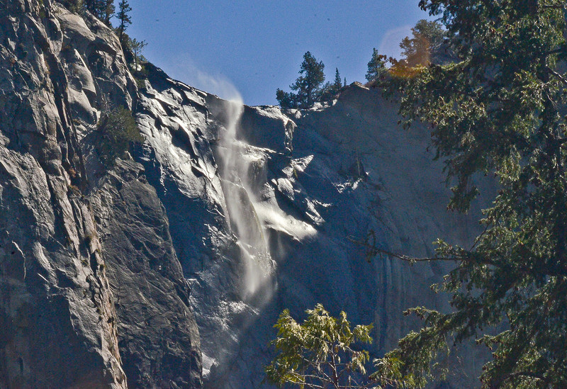 Bridalveil Fall cascading over the cliffs .... running at very low volume.
