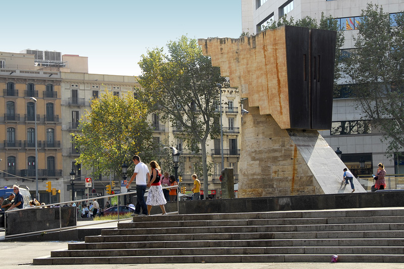 The inverted stair fountain at Placa de Catalunya. The Plaça de Catalunya, a large plaza surrounded by monumental buildings, is Barcelona's busiest square and also functions as a hub for the city's public transportation. Below the square is the main subway junction; three metro lines and a city railway line meet here. Many of the city's buses, as well as airport express and tourist buses stop here at the square.