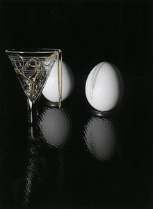 Glass, chain, and eggs